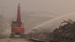 Fire fighting continues as demolition starts