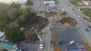 Pair of sinkholes shut down highway