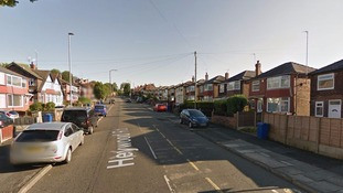 Boy, 11, held at knifepoint as masked gang break into family's home