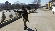 An Afghan policeman at the site of a suicide bomb attack in Kabul.