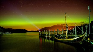 The Aurora Borealis shine over Derwentwater, near Keswick, a popular destination for tourists.