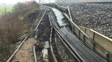 Engineers try to repair damaged train lines after landslip