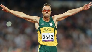 Oscar Pistorius celebrates winning Gold in a new Paralympic Record time during the Men's 400m - T44 Final