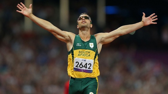 South Africa's Oscar Pistorius celebrates winning Gold in a new Paralympic Record time during the Men's 400m - T44 Final