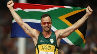 Oscar Pistorius holds South's Africa's flag