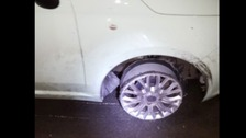 Police say the rims were glowing red when the woman was stopped