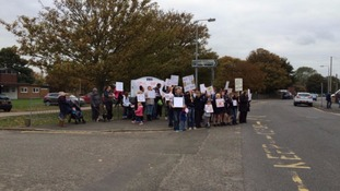 A demonstration outside the school in October