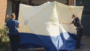 Police erect a tent outside the al-Hilli home in Claygate, Surrey