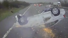 Miracle escape as overturned car skids across motorway