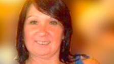 Man charged with murder after woman's body found in Neath