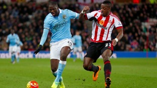 Manchester City's Yaya Toure and Sunderland's Lamine Kone battle for the ball