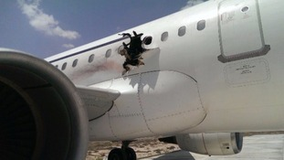 Somali plane lands with huge hole in its side after 'explosion'