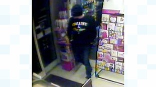 Police hunt for man who robbed shop with metal bar