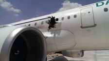 The hole in the side of the plane.