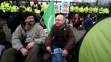 Scottish Green Party leader Patrick Harvie (right) joins anti-Trident demonstrators sitting on the road
