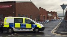 Hunt for armed robbers after man shot dead during warehouse raid