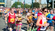 Runners cross over the Tyne Bridge during the 2015 Morrisons Great North Run, Newcastle.