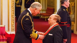 Sir Van Morrison was quizzed over his new material as he received his knighthood from Prince Charles.