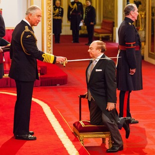 The knighting by royalty meant fans got a rare glimpse of their idol without his hat on.