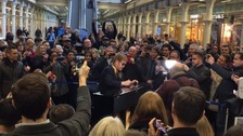 Elton John plays piano at St Pancras station