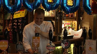 Phillip Cutter pulls his one millionth pint at The Murderers pub in Norwich.
