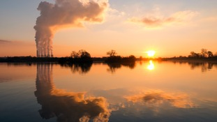 Attenborough Nature Reserve in Nottinghamshire reflected in the water during a sunsetl