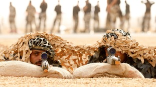 Members of Saudi special forces aim their guns during a training session