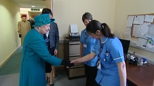 Many hands to shake as her Majesty met the team