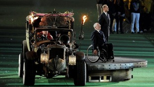 Prince Edward, Earl of Wessex, arrives with IPC President Sir Philip Craven (left) during the Paralympic Games closing ceremony.