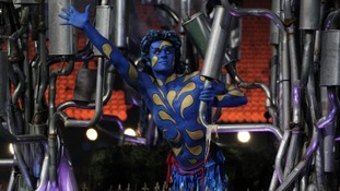 A dancer painted in blue and yellow.