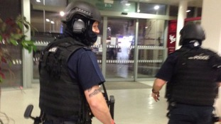 More than 30 armed officers storm London-bound train during manhunt