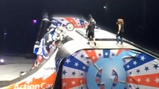 The stunt goes wrong sending the riders falling down the ramp