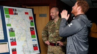Prince Harry meets with army personnel who helped with the Christmas floods