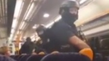 Armed police board train after woman's death