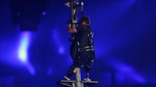 Captain Luke Sinnott climbs a flag pole during the Closing Ceremony