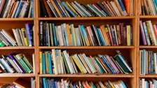 Books stacked on a library shelf
