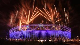 Fireworks explode over the Olympic Stadium