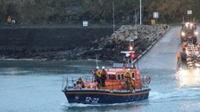 lifeboat and crew entering the water