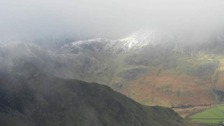 misty snow capped Robinson fell