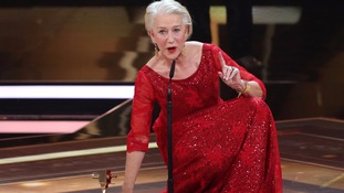 Helen Mirren improvises during awards acceptance speech as mic slips to down to half her height