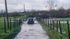 Warning issued after heavy rain leaves roads flooded