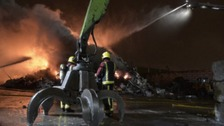 Firefighters damping down blaze at recycling plant in Nechells
