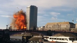 A bus explodes on Lambeth Bridge as a special effect for a new film.
