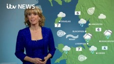 Emma Jesson in front of weather graphic