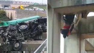 Boy rescued after dangling from bridge after car crash