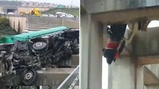 Boy rescued after dangling from bridge after car crash