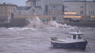 Winds crashed high waves at Weston-super-Mare's seafront as Storm Imogen lashed the south of Britain.