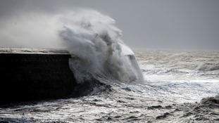 People along the coastline have been warned to take care with waves easily clearing the harbour walls.