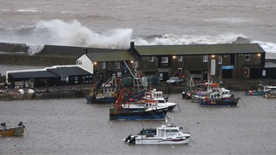 Waves crashed high against the harbour wall in Lyme Regis as Dorset was hit with winds of nearly 100mph.