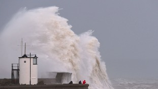 Waves crash over the sea wall at Porthcawl